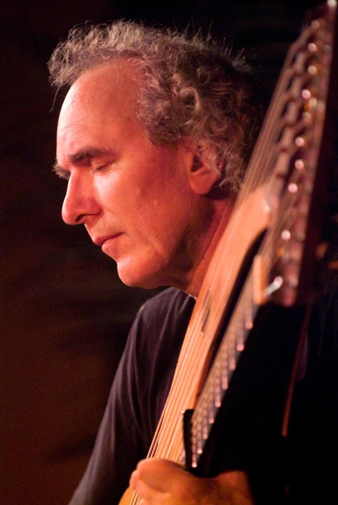 John Doan in concert with harp guitar closeup on stage Jenks Hall Portland Oregon