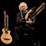 John Doan playing Brunner Harp Guitar on stage in concert