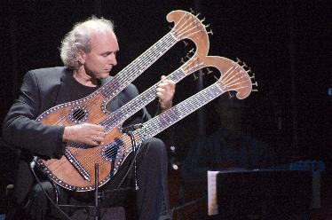 john Doan Primal Twang Harpolyre - Photo, Erin Fitzgerald Taylor Guitars