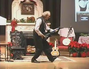 John Doan in concert with his popular Victorian Christmas Show playing electric guitar