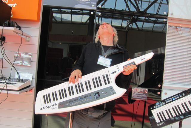 John Doan jamming on an electric piano guitar in Moscow.