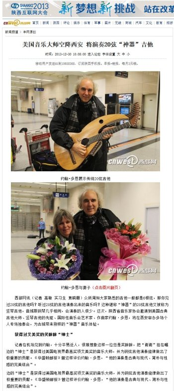 From Chinese newspaper, reporters interview John Doan on arrival in China for harp guitar concert and lecture tour.