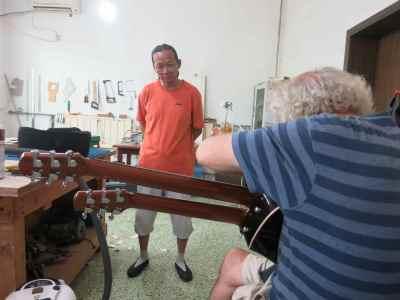 32. Mr. Xi looks on John Doan Harp Guitar