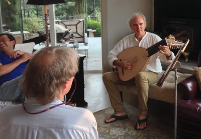 John has the audience in stitches as he starts to play the lute.