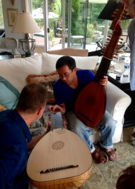 Phil and Hideki try to determine whose lute is bigger