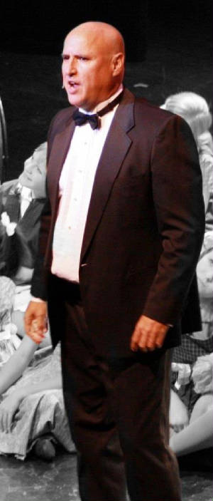 John George Campbell as Oliver Warbucks in ANNIE
