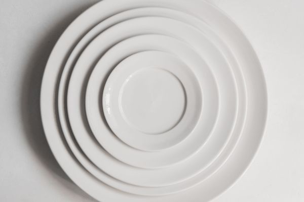 Porcelain plates in a stack