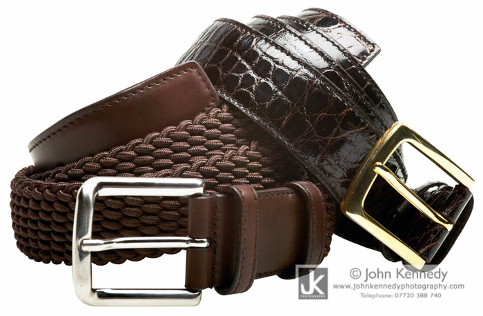 Two leather belts entwined, a clients product photograph.