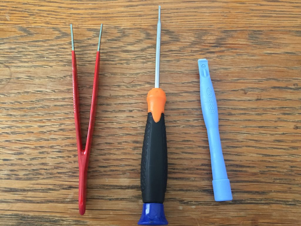 iPod opening tools. Tweezers, Small screwdriver & iPod opening tool (soft tool or spudger)