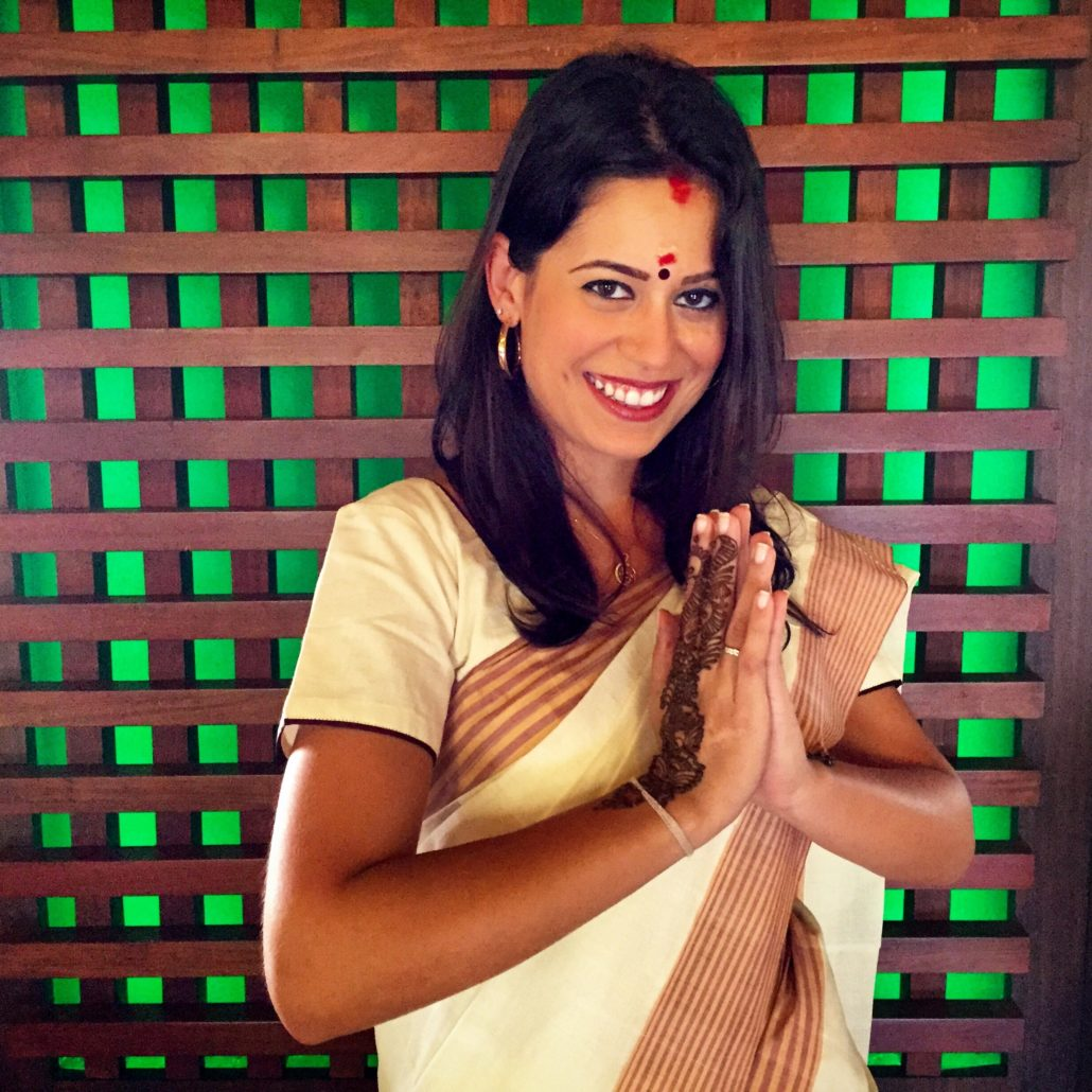 Wearing a traditional Kerala saree