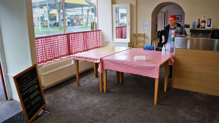 Only one customer at a time is allowed into the café and only for takeaway food.