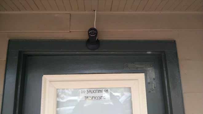 Our front door camera and grumpy old man sign.