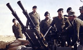 Saddam with his troops