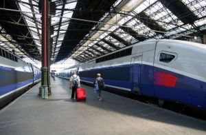 Paris, Gare de Lyon: People with luggage walking to their train.