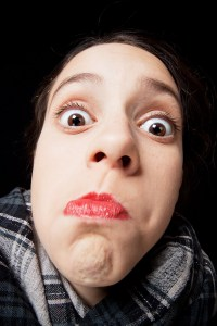 Young teenage girl making funny stupid face