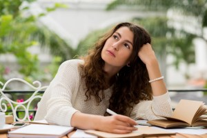 Female journalist thinking of new ideas for her article