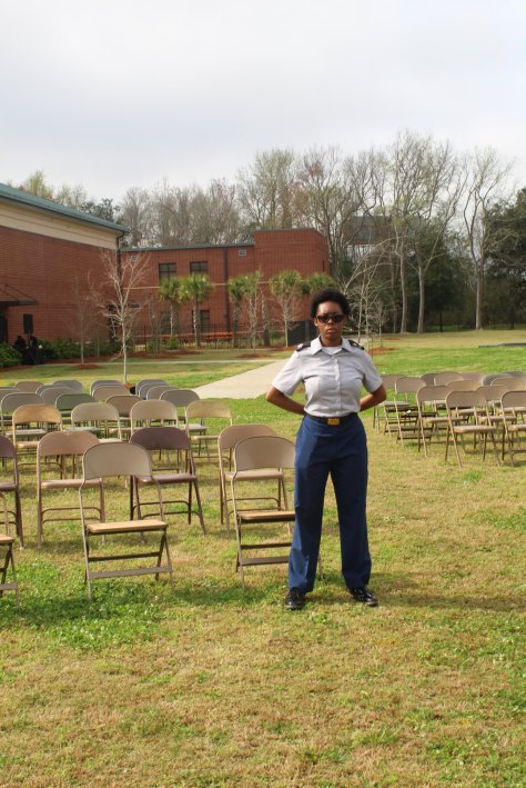 Jr. Cadet stands guard of 436 chairs representing those sold during the Weeping Time  Kiplyn Primus