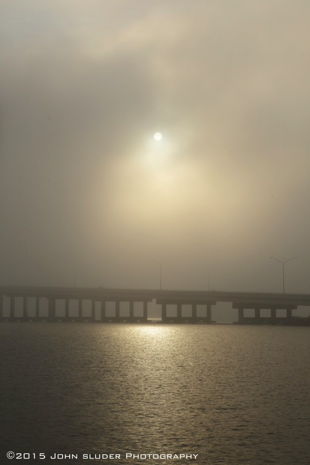 Morning Fog, sun raising over the Eau Gallie Causeway