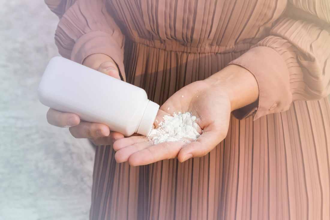 Women hand apply talcum powder