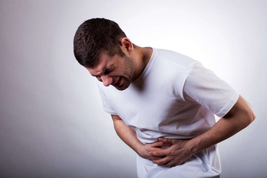 man experiencing abdominal pain