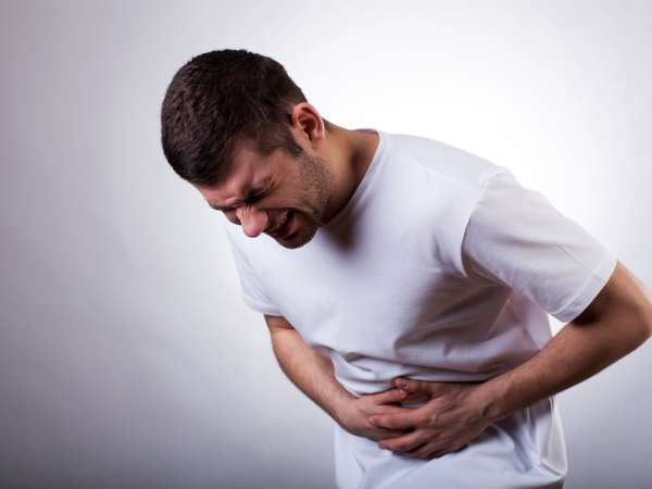 man experiencing abdominal pain