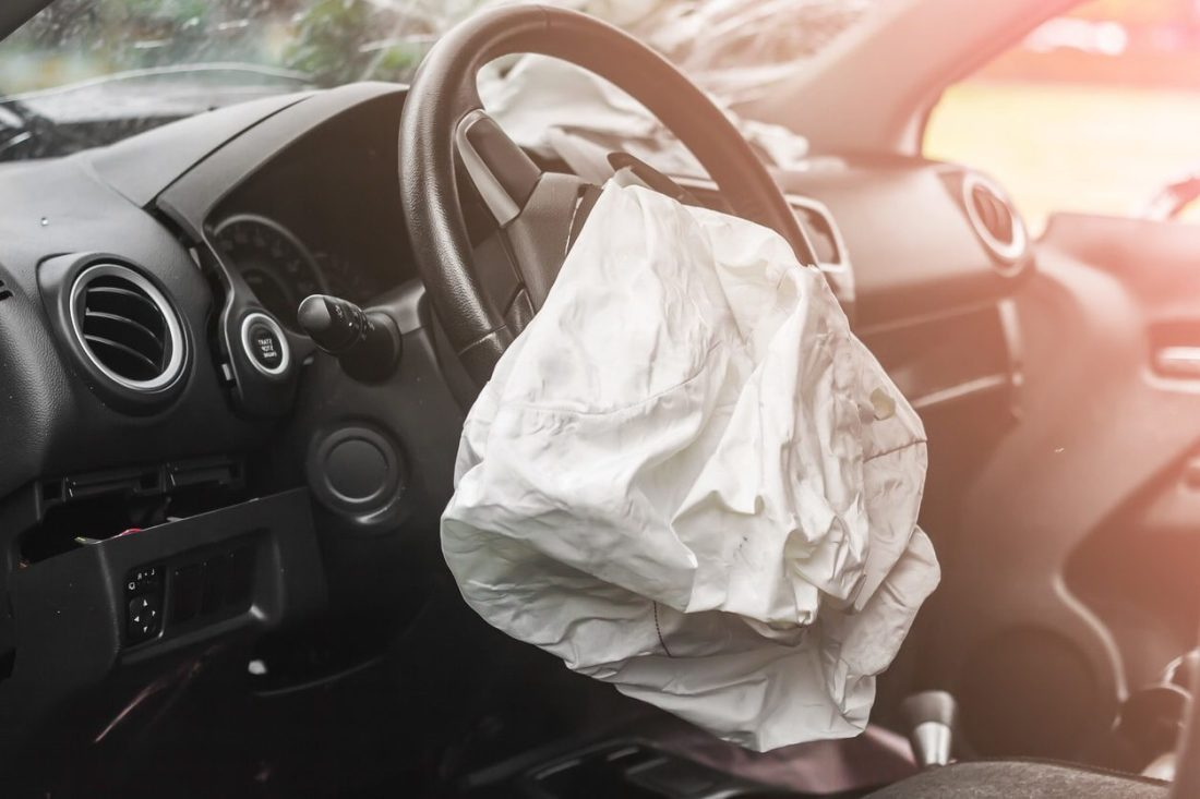 Side view of airbag deployed in vehicle