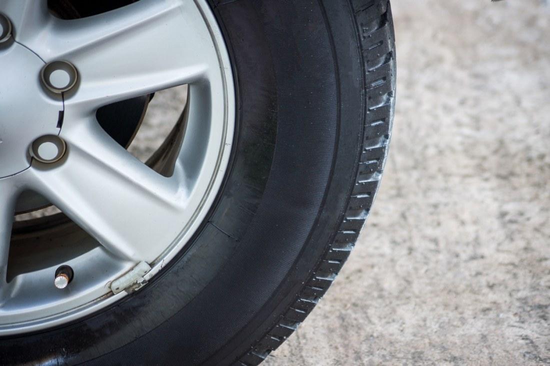 side of truck wheel on cement