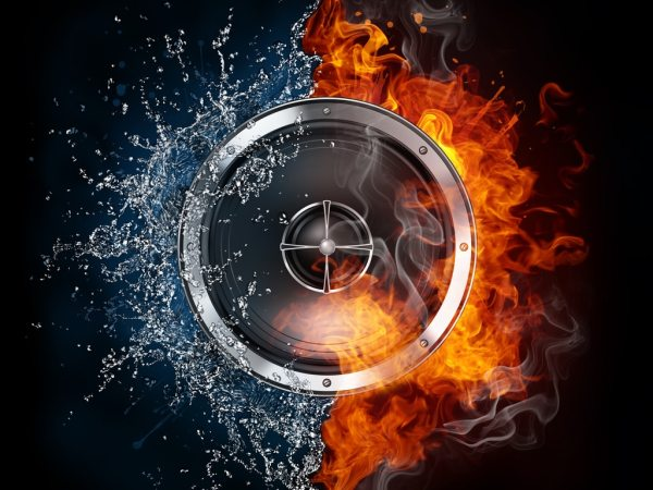 black background, image of speaker with flames and water exploding on either side