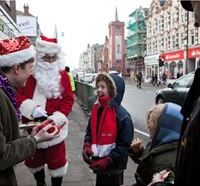 Santa and his Elves capture this child's imagination in London