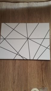 Use thin tape to cover sections of your canvas for this wall art design.