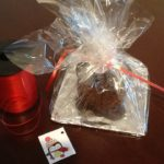 Gather up and tie the cellophane with a piece of ribbon. The christmas cake then needs to be tagged.