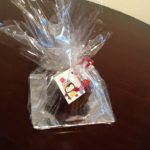 Wrapped Christmas cake ready for a lucky recipient