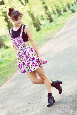 UK teen fashion blogger wearing floral pinafore in Haslam Park Preston