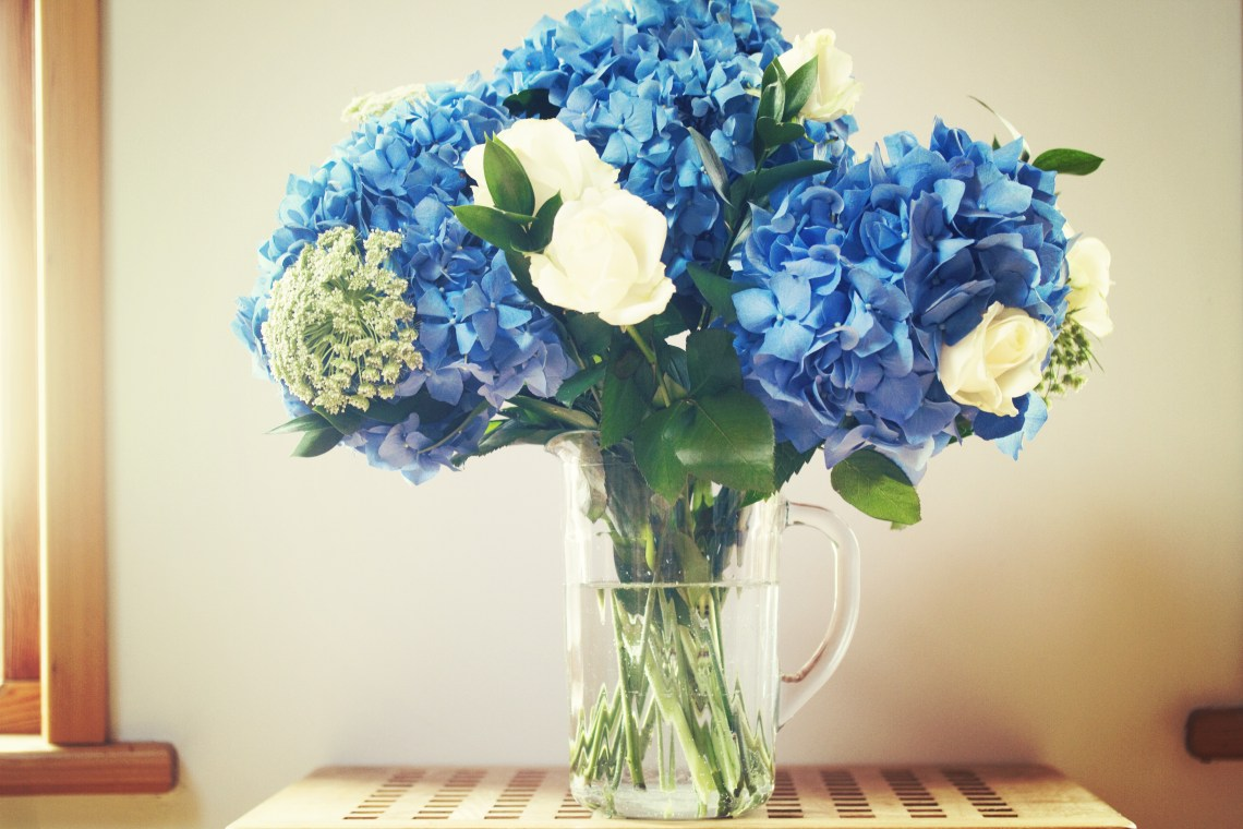 hydrangea arrangement in clear glass jug