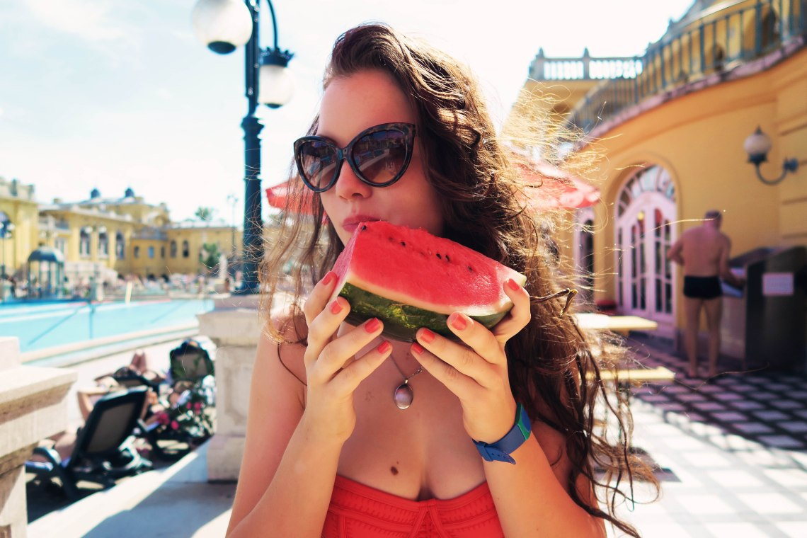 Eating watermelon at Szechenyi baths Budapest, Hungary