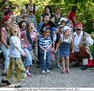"Children taking part in a Jolly Good Productions pirate day activity with pirate "" Ron """
