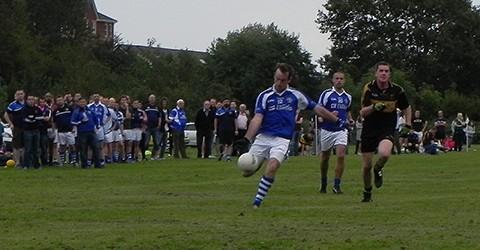 Sean Roddy kicks the ball in a match