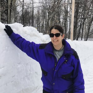 Jennifer next to a snowbank