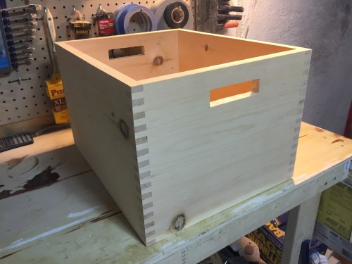 The box is glued together and has handles cut in it