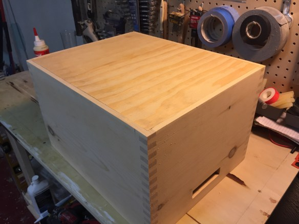 Gluing the bottom into the boxes
