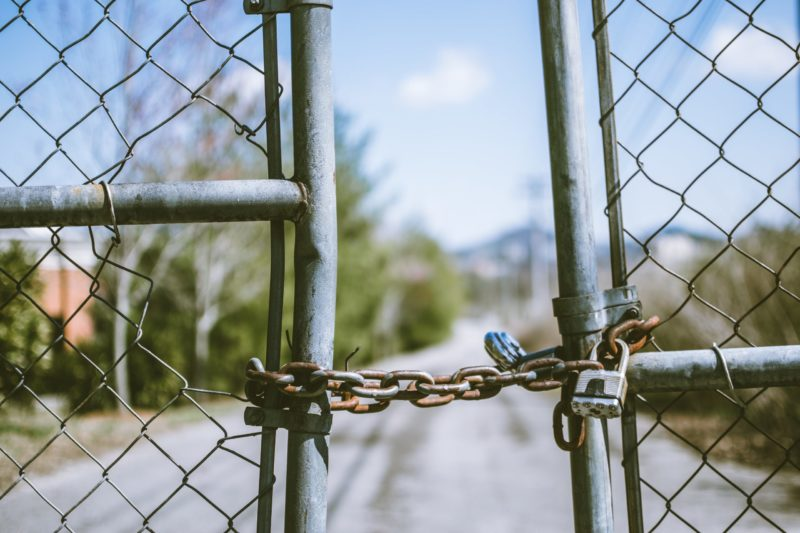Picture of a fence with a padlock