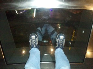 "The glass-floored portion of Sky Tower's main observation deck. Below my feet are 1.5"" of glass, then 610 ft of empty space. :)"