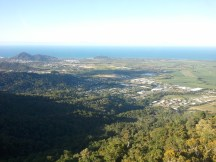 The Skyrail's last stop was Cairns; this is the view of the cableway's final descent. In the foreground is the eastern edge of the rainforest, with Cairns in the middleground, and Pacific Ocean in the background.