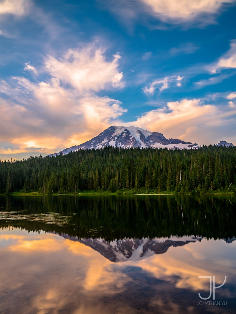 Early fiery colors mixed with deep blue skies at Reflection Lake