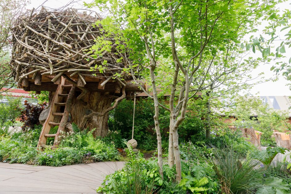 The RHS Back to Nature Garden - a woodland walkway and treehouse.