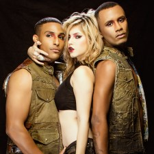 Two male models in distressed fashion beside blonde model in black top