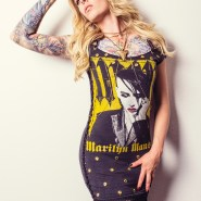 Blonde tattooed model in black Marilyn Manson fringe dress.