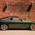 Green 1978 water-cooled Porsche 928 in Downtown LA. Photographed by Jon White.