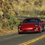 Red Porsche Cayman on the Angeles Crest highway in Los Angeles,CA.