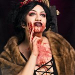 Portrait of brunette model with blood streaked face.